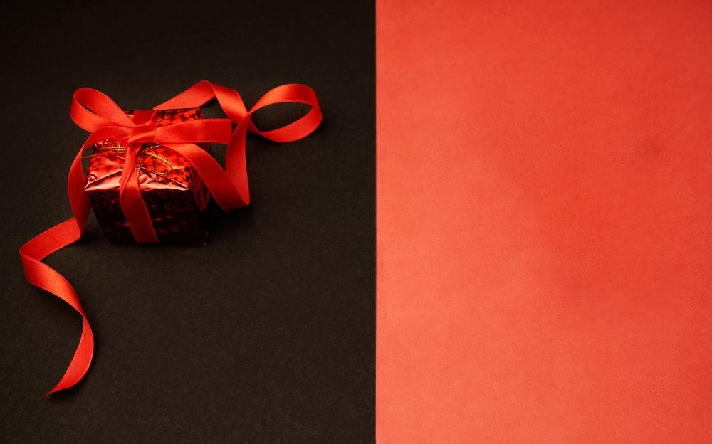 red and white ribbon on black surface